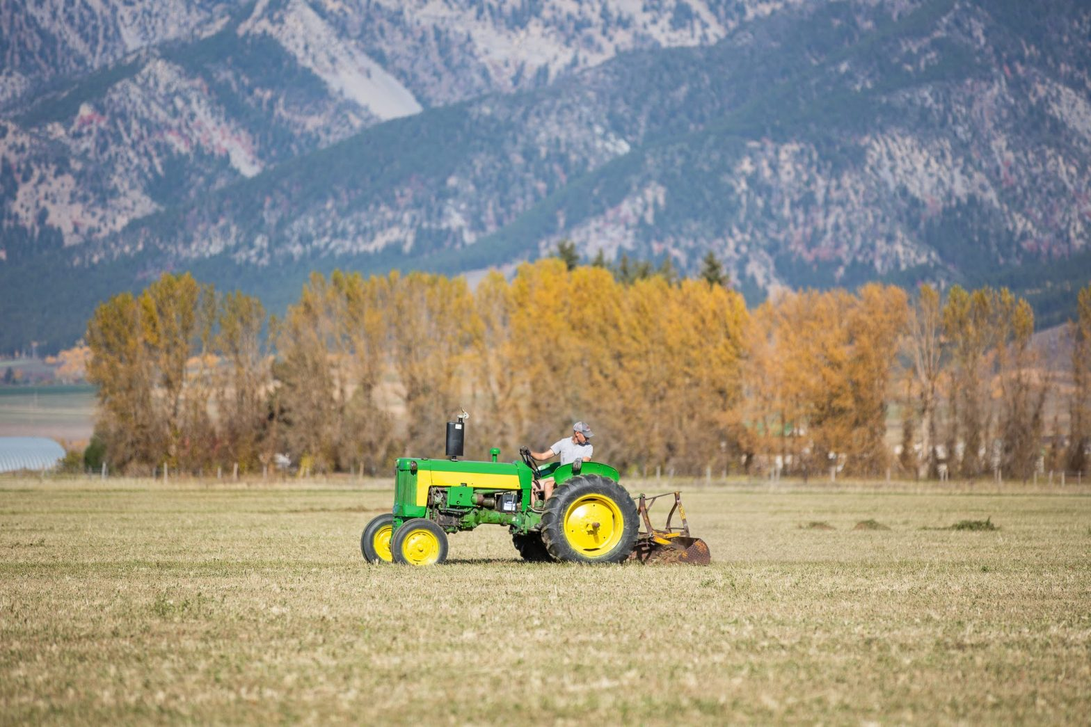 John Deere 435 with mountains
